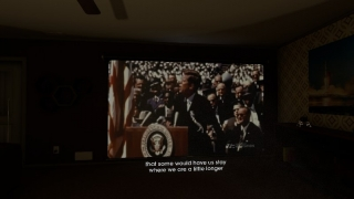 The game sets the historical context with a President Kennedy speech spliced with images.