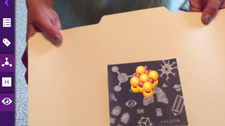 "Augmented reality lets kids ""hold"" their compounds."