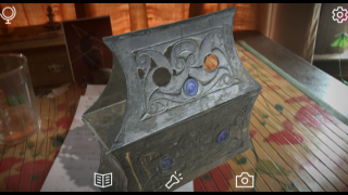 Touch the screen to rotate and scale the artifact.