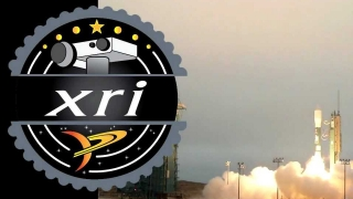 The fictional XRI company is behind the project.