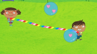 Each player holds a character to move the rope around and catch bubbles that hold the target number of treasures.