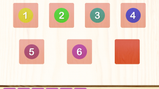 Colored square tiles along the bottom of the screen correspond with the numeral.