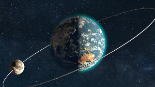 The Earth shows off its atmosphere and the not-to-scale moon's orbit.