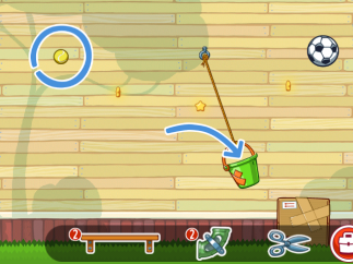 A backyard-level puzzle shows the goal highlighted in light blue and supplies and tools for solving the puzzle at bottom.