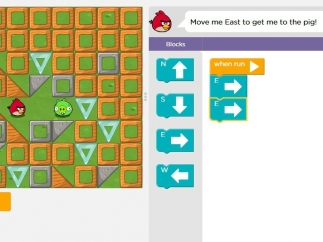 Using lines of code, students move the Angry Birds character to the Bad Piggie.