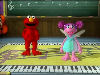 Elmo and Abby want you to get up and dance.
