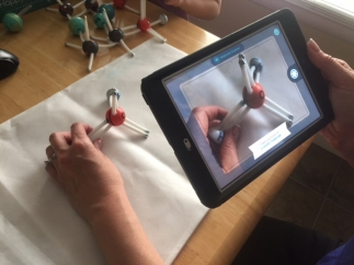 Explore molecules using your device by scanning the physical model.