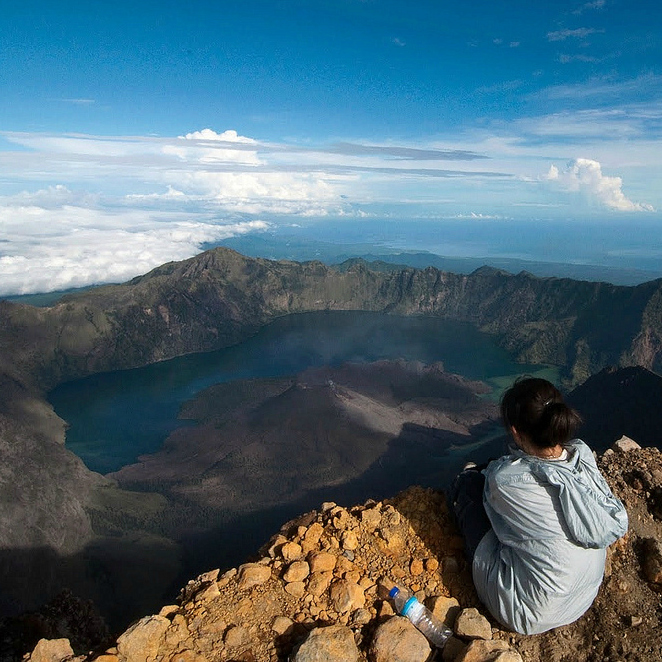 hiker looking at scenery from Mount Rinjani